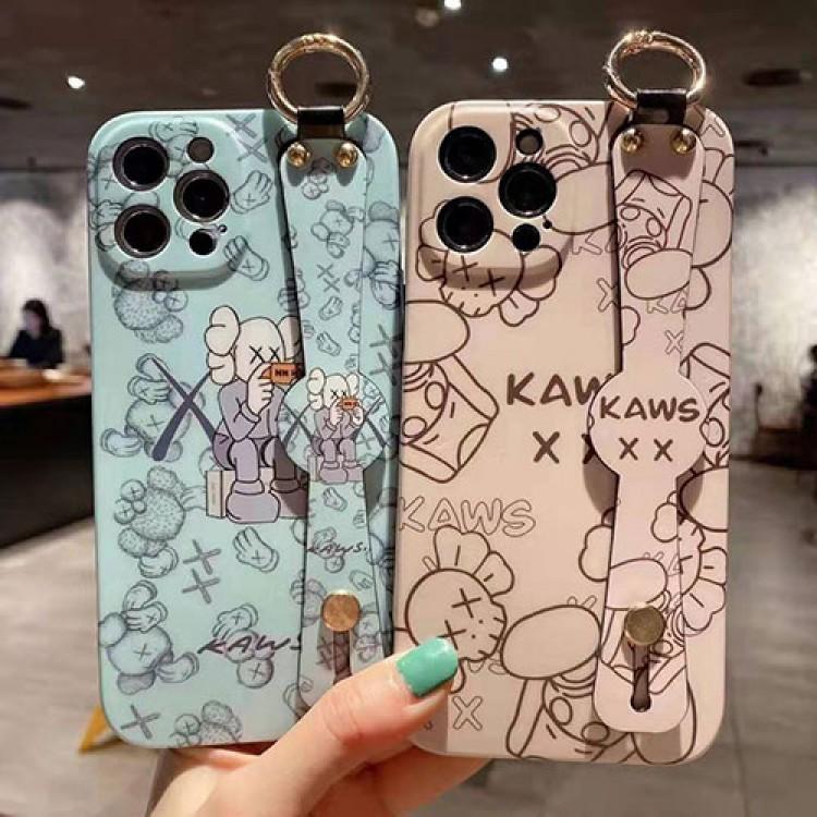 カウズ ブランドiphone12/12pro max/12 mini/12 pro maxケース ハンドバンド付き 韓国風 ホルダー付 KAWS 個性潮 iphone x/xr/xs/xs maxケース 落下防止 ファッション ins風 iphone 11/11 pro/11 pro maxケース かわいい iphone x/8/7 plusケース大人気